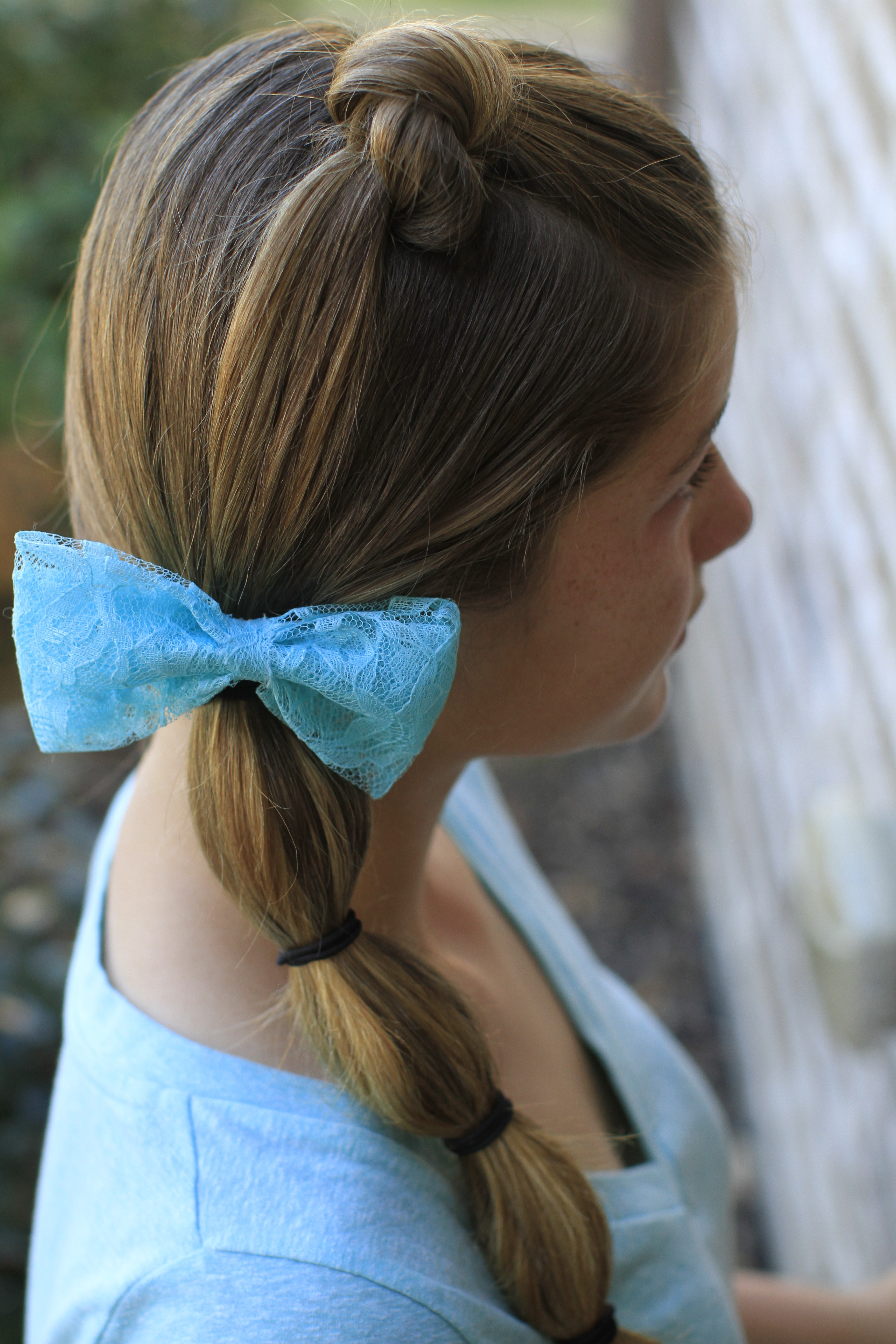 Hairstyle Video: Top Knot into Banded Side Ponytail
