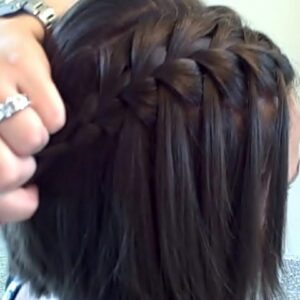 Woman holding her Waterfall Braid (DIY)