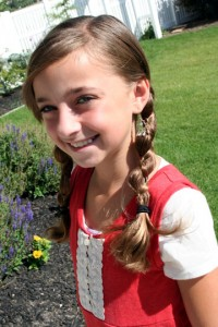 Portrait view of young girl modeling Loony Braids | Crazy Hairstyles