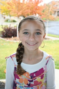 Portrait of young girl modeling the Double-Twist into Side Braid