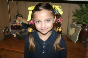 Portrait view of young girl modeling the Egg Tails hairstyle | Easter Pigtails