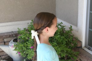 Side view of the Double Twist Ponytail