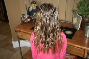 Back view of the Waterfall Braid Hairstyle with Spiral Curls