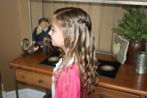 Side left view of the Waterfall Braid Hairstyle with Spiral Curls