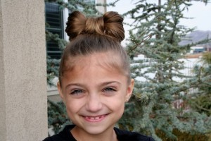 Portrait of young girl modeling the Lady Gaga Bow Hairstyle