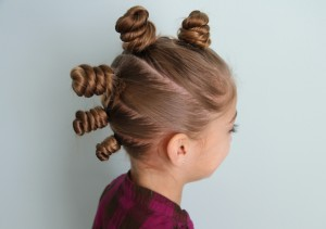 Side back view of The Bun Hawk Hairstyle | Crazy Hair Day Hairstyles
