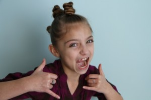 Portrait view of young girl modeling The Bun Hawk | Crazy Hair Day Hairstyles