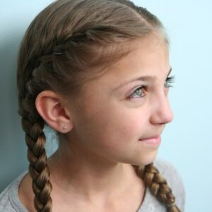 Portrait view of young girl modeling the Primrose Everdeen Braids | Hunger Games Hairstyles