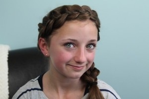 Portrait view of young girl modeling the Wrap-Around Dutch Pancake Braid | Braid Hairstyles