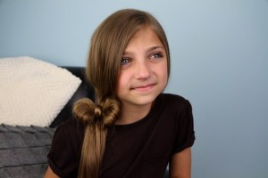 Portrait view of a young girl modeling the Side Ponytail Hair Bow | Cute Hairstyles