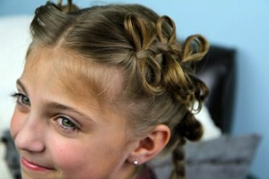 Portrait view of young girl modeling The Bow Braid | Cute Girls Hairstyles