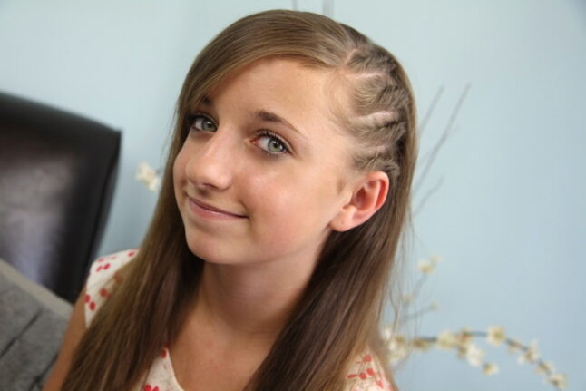 Portrait of a young girl modeling Side Flat Twists | Back-to-School Hairstyles