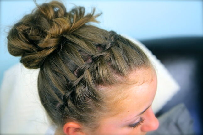 Top side view of Waterfall Braided Headband into a Messy Bun.