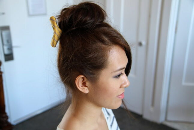Side view of Teased High Bun Hair Jewelry   Updo Hairstyles   Prom