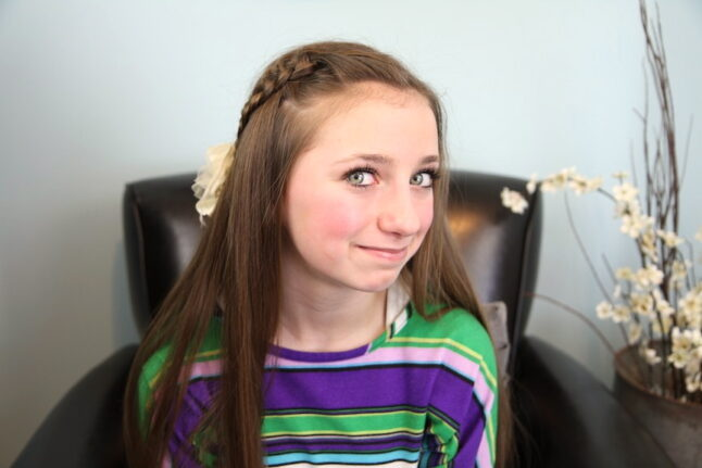Portrait of a young girl modeling 4-Strand Slide Up Braid   Cute Girls Hairstyles