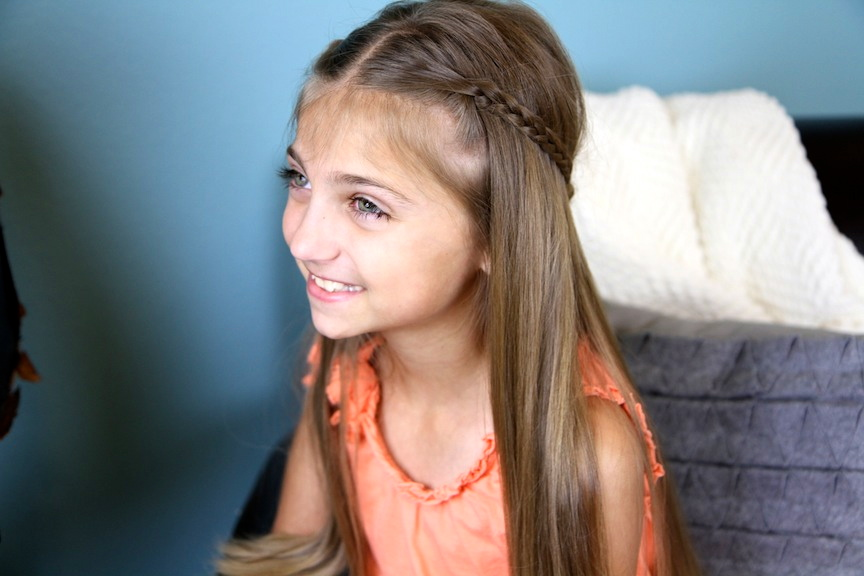 Portrait of little girl modeling Cute Braided Flower Tieback | Hairstyles for Long Hair