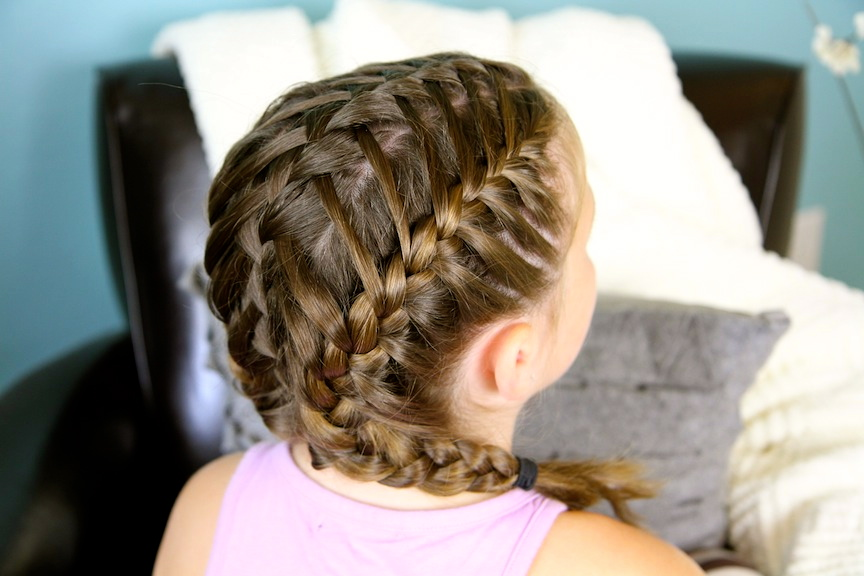 Back view of young girl modeling Waterfall Braids into Double Frenchbacks | Sport Hairstyles