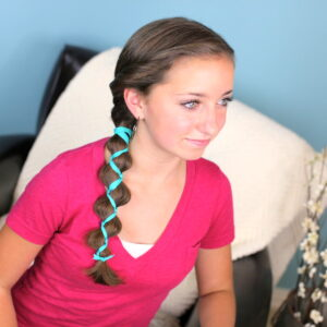 Young girl indoors modeling Ribbon-Accented Loony Braid | Hairstyle Ideas
