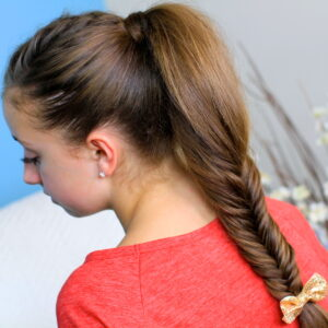 Back view of young girl wearing a red shirt modeling Fluffy Fishtail Braid | Hairstyles for Long Hair