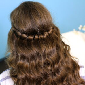 Back view of young girl indoors modeling Headband Twist | Half-Up Half Down Hairstyles