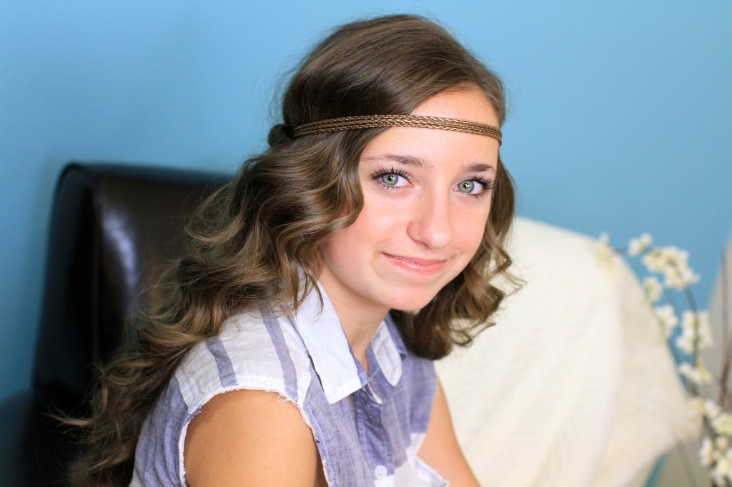 Portrait of a young girl indoors modeling Headband Twist | Half-Up Half Down Hairstyles