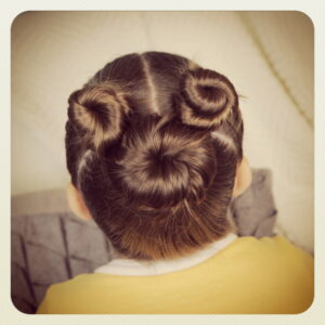 Back view of little girl modeling Not-So-Hidden-Mickey | Disney Hairstyles