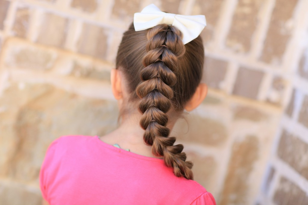 (Back) Young girl outside modeling Pull-Through Braid | Easy Hairstyles