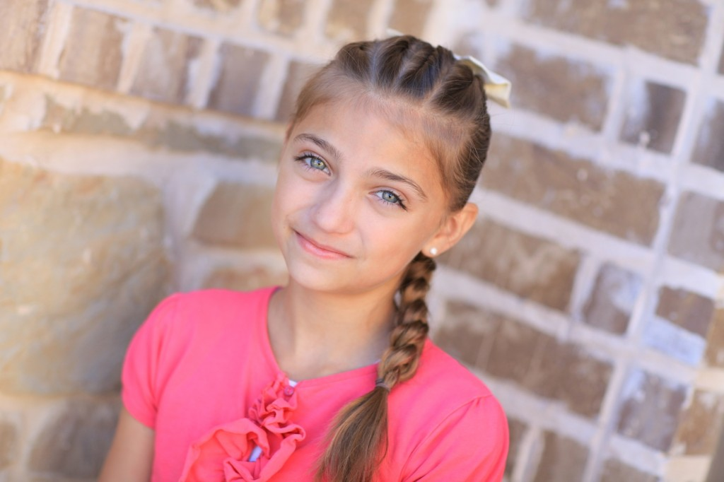 Portrait of young girl outside modeling Pull-Through Braid | Cute Braids
