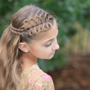 Young girl outside modeling Prim Bow Braid Tieback | Catching Fire | The Hunger Games