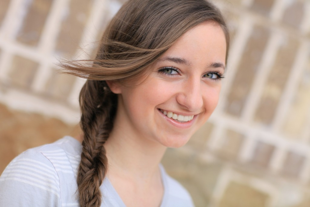 Portrait of a young girl outside modeling Double Fishtail Twist | Braid Hairstyles