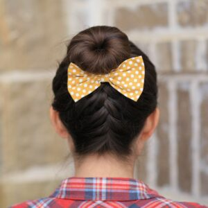 (Back) Young girl outside modeling French-Up High Bun | Updo Hairstyle Ideas