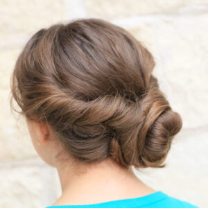 (Back) Young girl outside modeling Easy Twist Updo | Prom Hairstyles