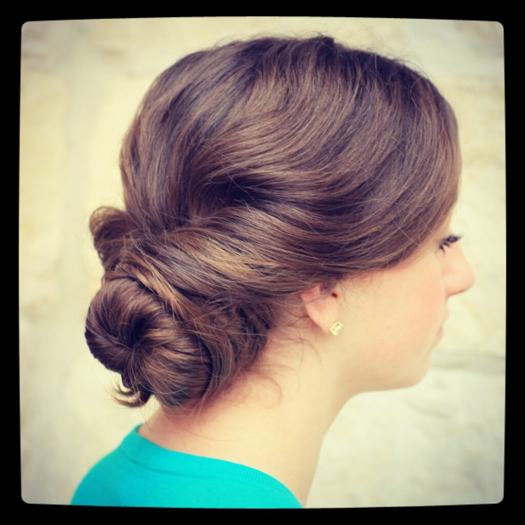 Young girl outside modeling Easy Twist Updo | Prom Hairstyles
