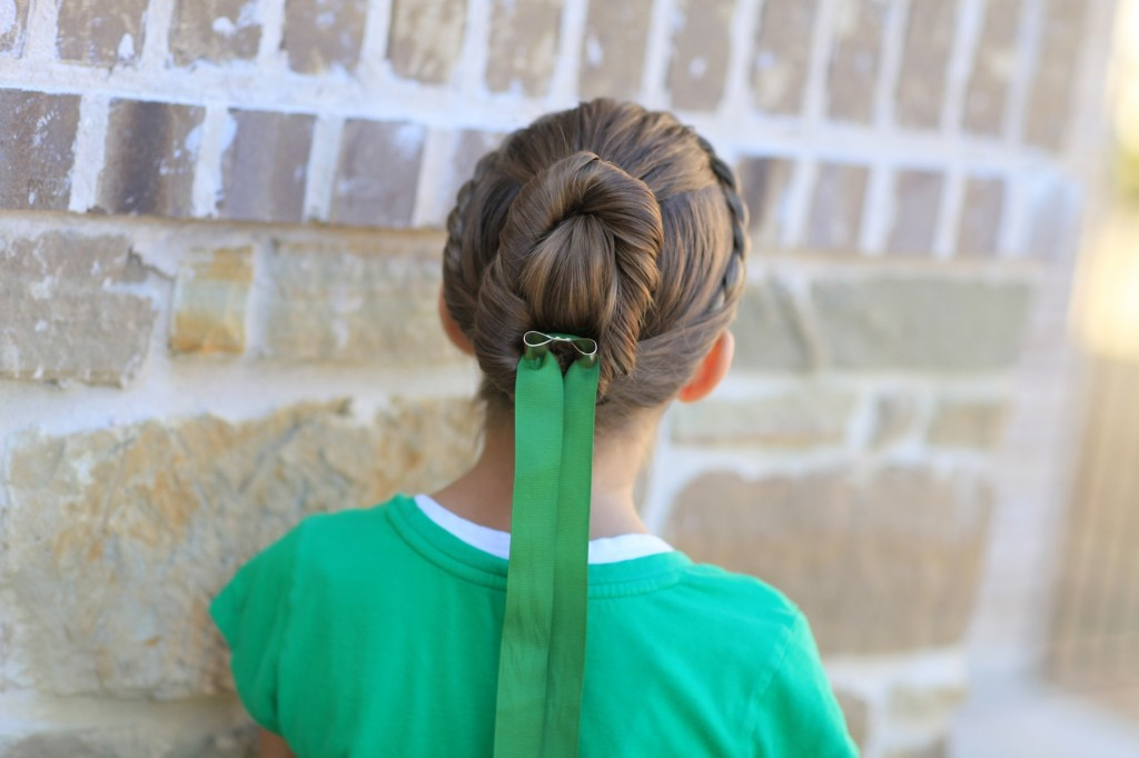 Young girl modeling Disney Frozen inspired Anna's Coronation Hairstyle