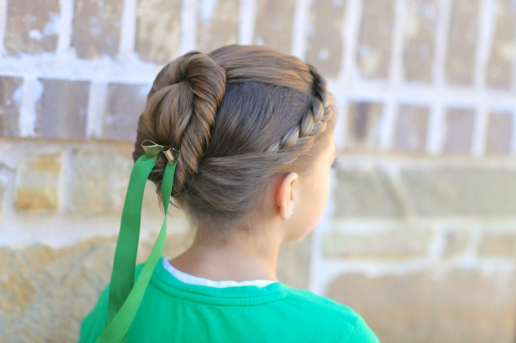 Young girl outside modeling Disney Frozen inspired Anna's Coronation Hairstyle