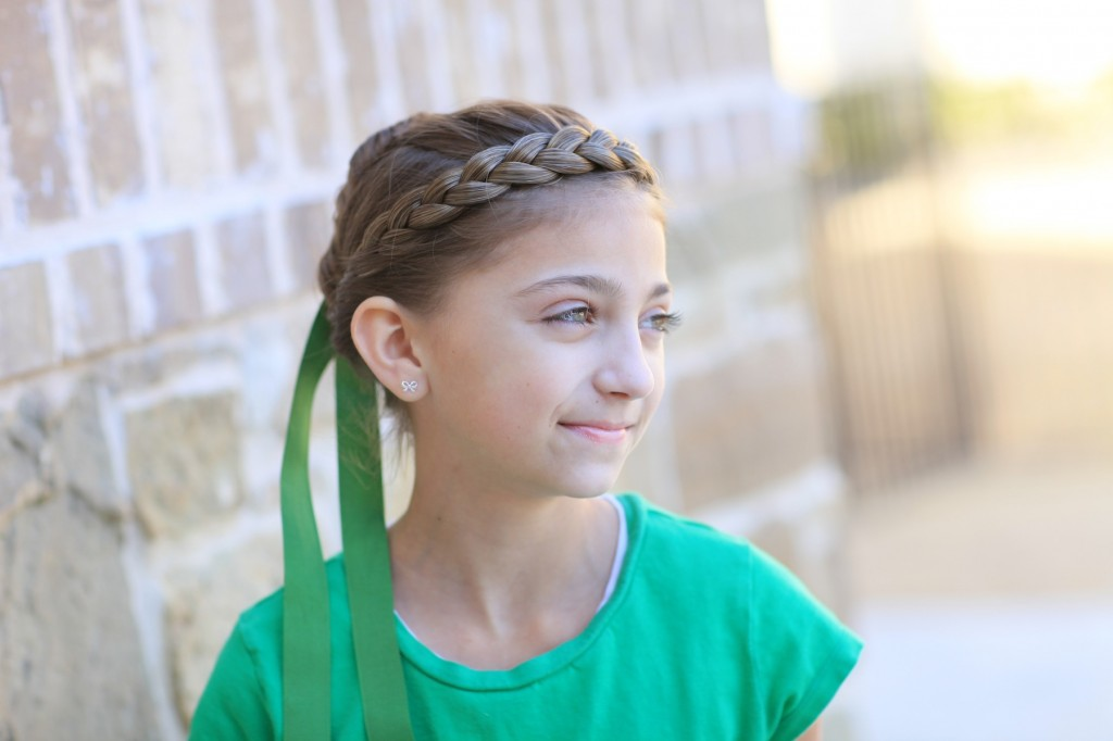 Portrait of young girl modeling Disney Frozen inspired Anna's Coronation Hairstyle