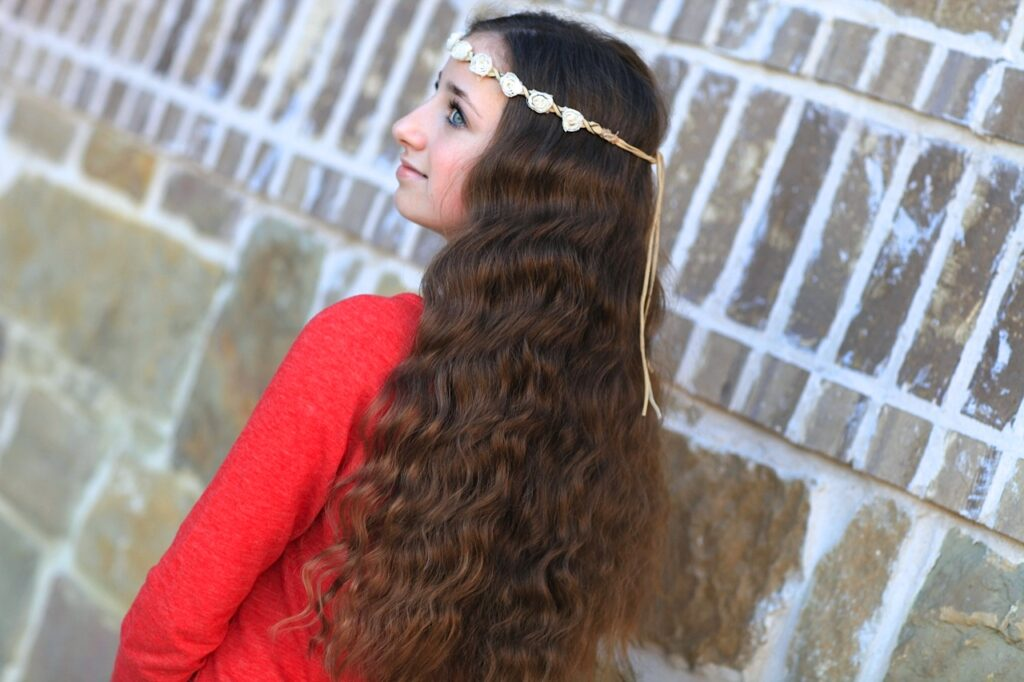 Young girl outside modeling No-Heat Bandana Curls
