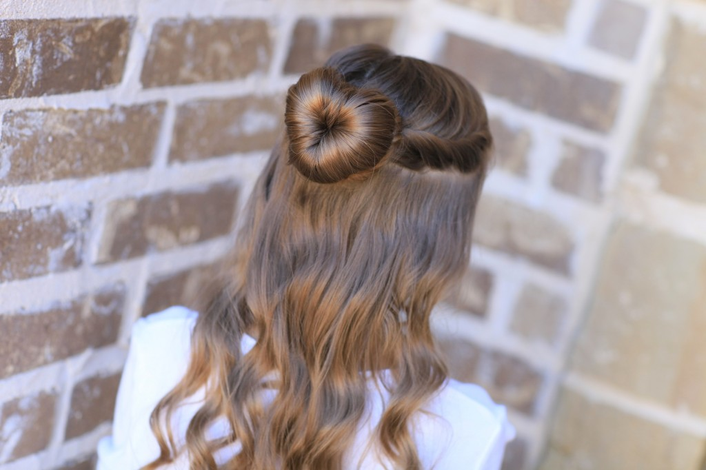 Young girl outside modeling Love Bun | Valentine's Day Hairstyles