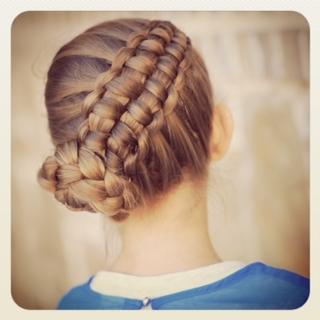 Little girl outside in a blue shirt modeling Zipper Braid | Updo Hairstyles