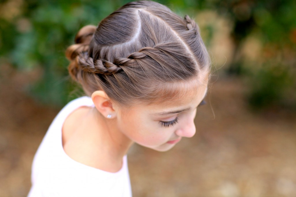 Young girl outside modeling Rope Twisted Heart | Valentine's Day Hairstyles
