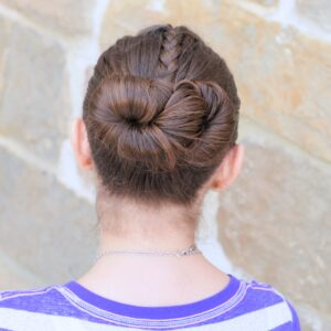 Young girl outside modeling Infinity Bun | Updo Hairstyles (Back)