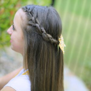 Young girl outside modeling Knotted Braid Tieback