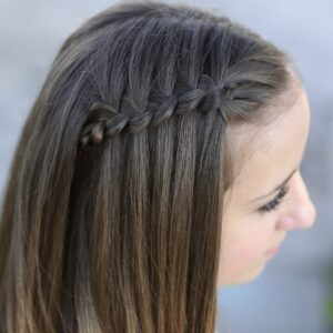 Young girl outside modeling Four-Strand Waterfall Braid