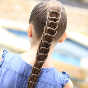 Young girl outside modeling The Knotted Ponytail | Cute Hairstyles