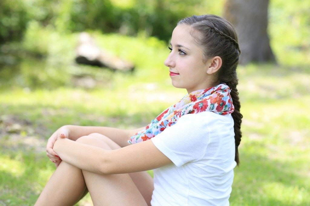 Young girl outside modeling Laced Fishtail Braid
