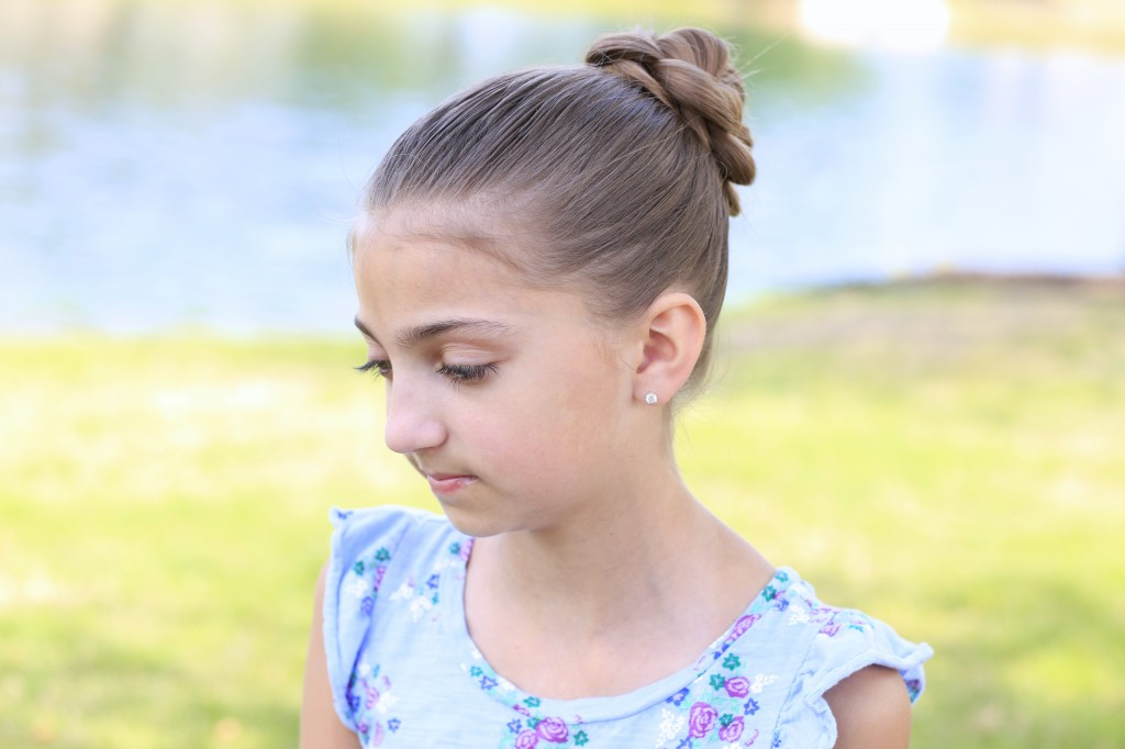 Little girl sitting outside modeling 3D Flower Bun Updo