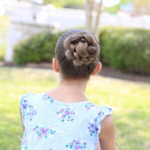 Little girl sitting outside modeling 3D Flower Bun Updo