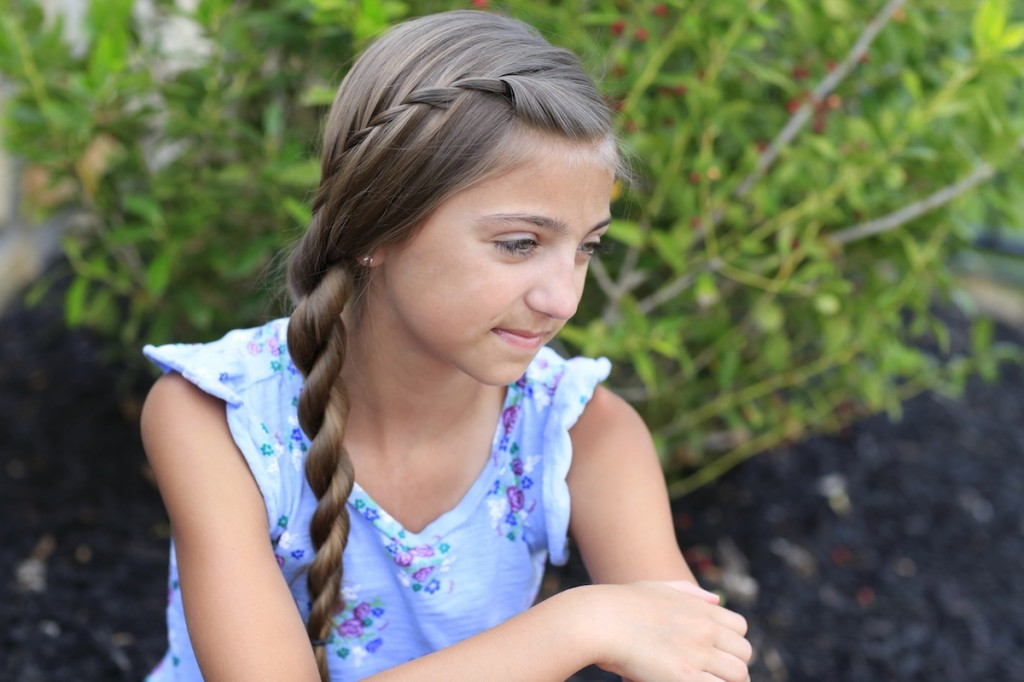 Little girl sitting outside modeling Waterfall Twist Into Rope Braid