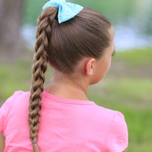 Little girl outside wearing a pink shirt modeling 3D Split Braid