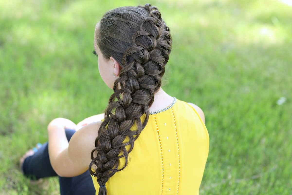 "Young girl outside in a yellow shirt modeling ""Diagonal French Loop Braid"" hairstyle"